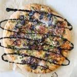 springtime portobello, asparagus + prosciutto pizza with balsamic glaze.