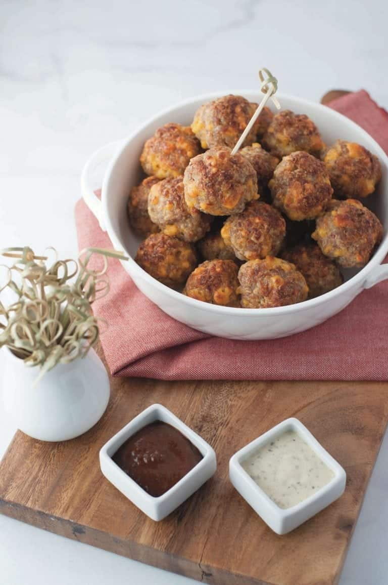 Keto Sausage Balls with barbecue and ranch dipping sauces