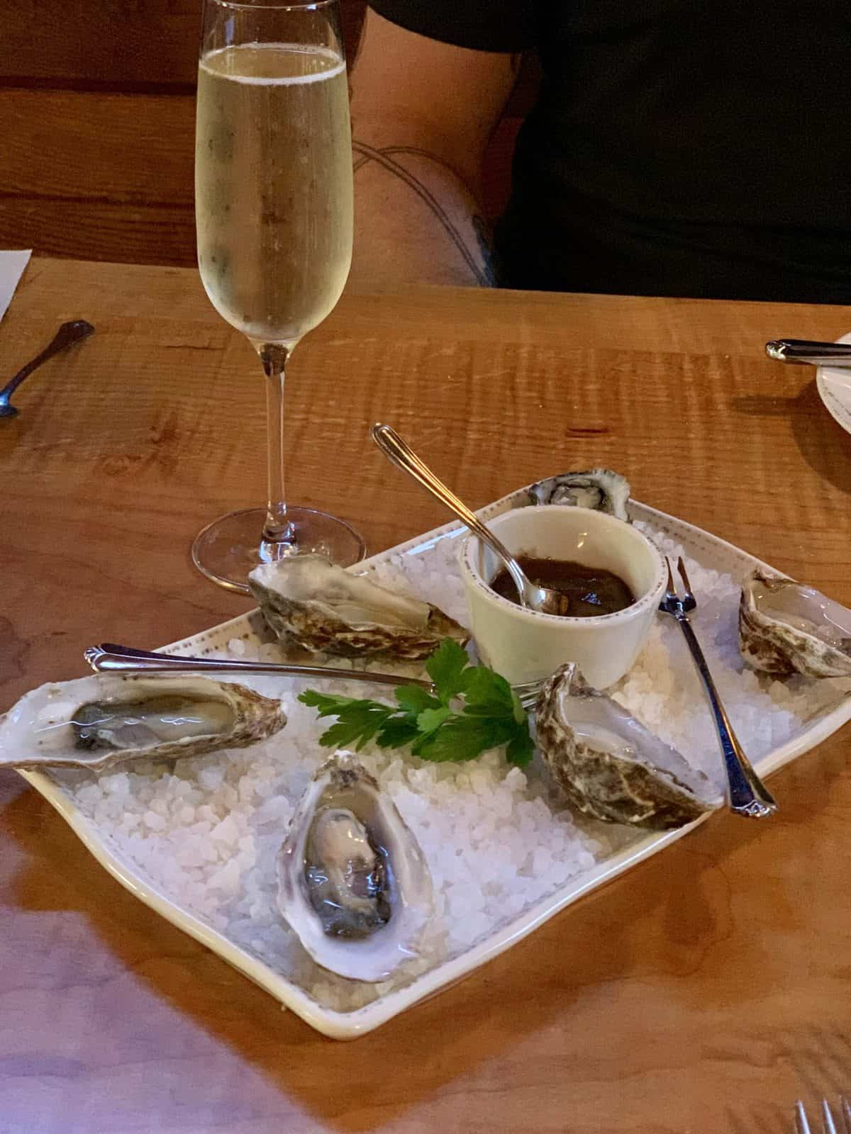 Plate of oysters on the half shell and a glass of champagne