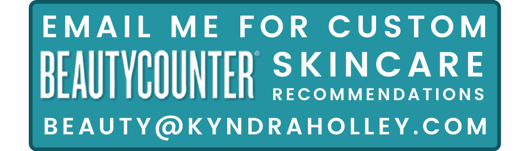 "A small rectangular button with a teal fill and a dark blue outline. Text on the button reads: ""EMAIL ME FOR CUSTOM BEAUTYCOUNTER SKINCARE RECOMMENDATIONS BEAUTY@KYNDRAHOLLEY.COM"""