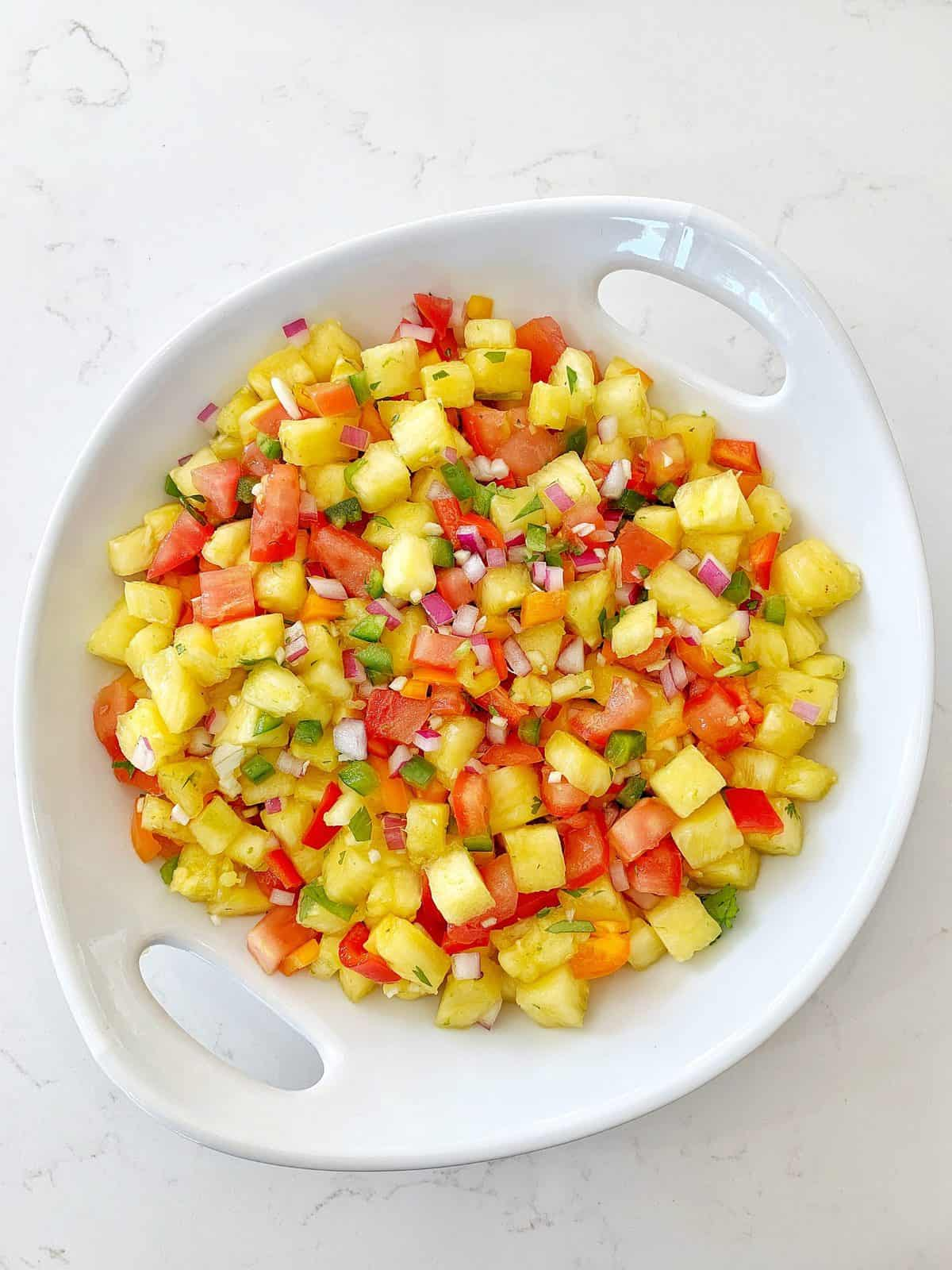 Overhead shot of fresh Pineapple Salsa in a white bowl