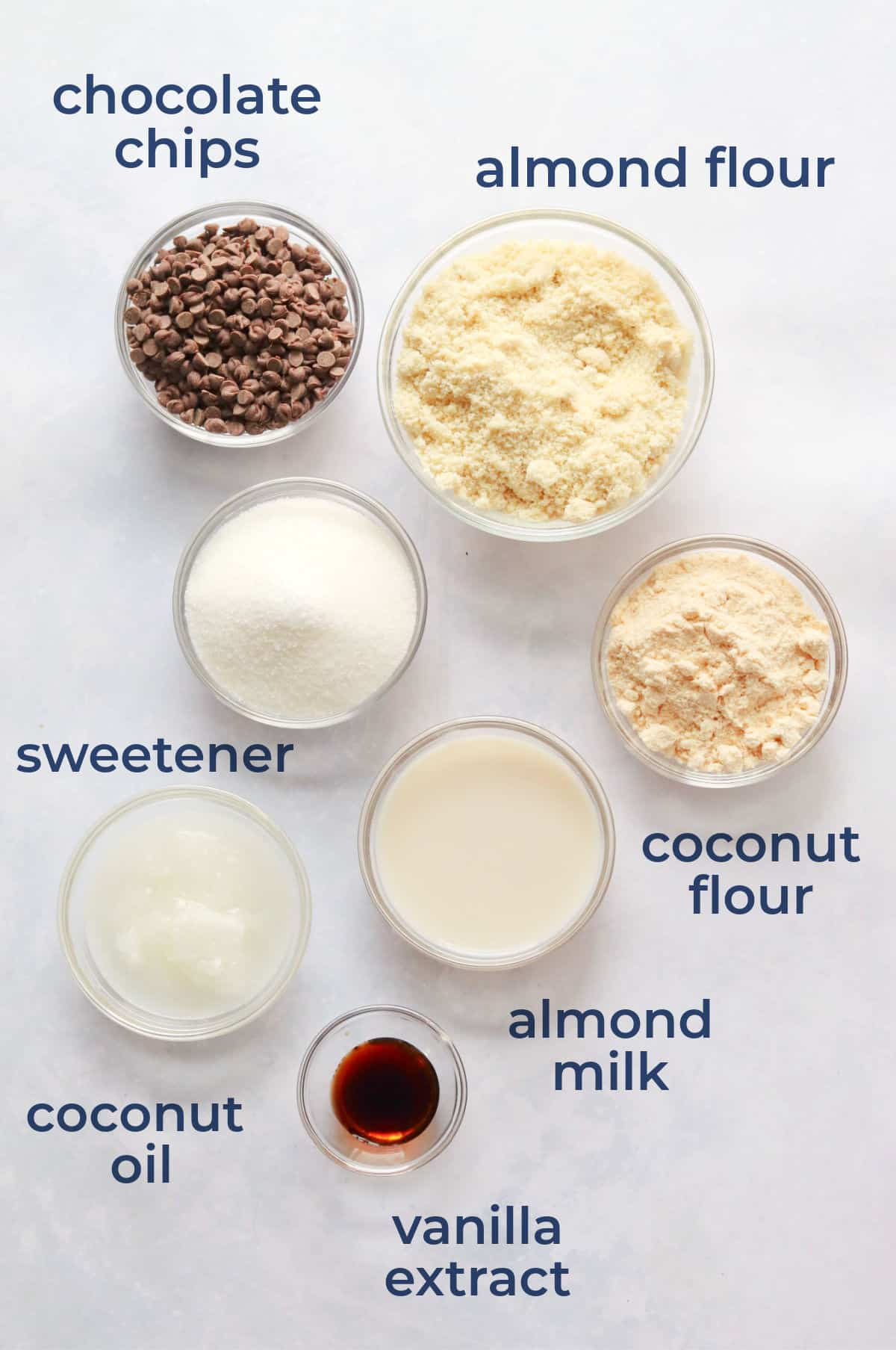 Ingredients for cookie dough bites - almond flour, coconut flour, chocolate chips, vanilla, sweetener