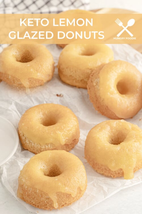 low carb glazed donuts piled up on white parchment paper