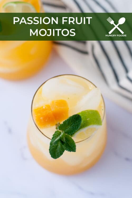 passion fruit mojito over ice, garnishes with lime mint and passion fruit, served with a stainless steel straw