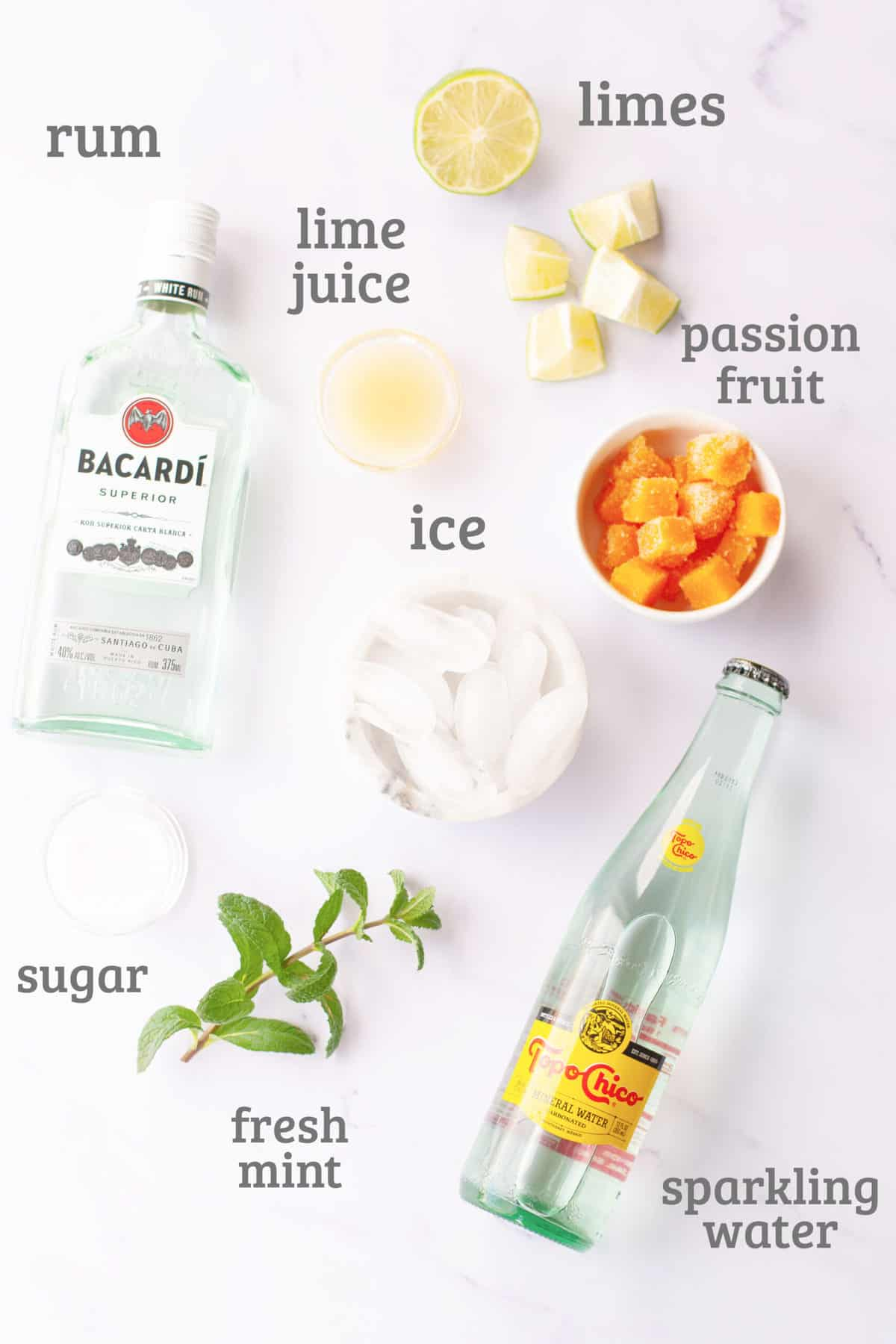 Ingredients for passion fruit mojitos - limes, rum, mint, sugar, passion fruit