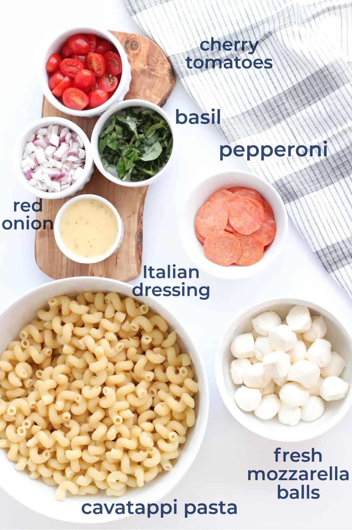 Ingredients for Pepperoni Caprese Pasta Sald - pasta, pepperoni, basil, mozzarella and Italian dressing