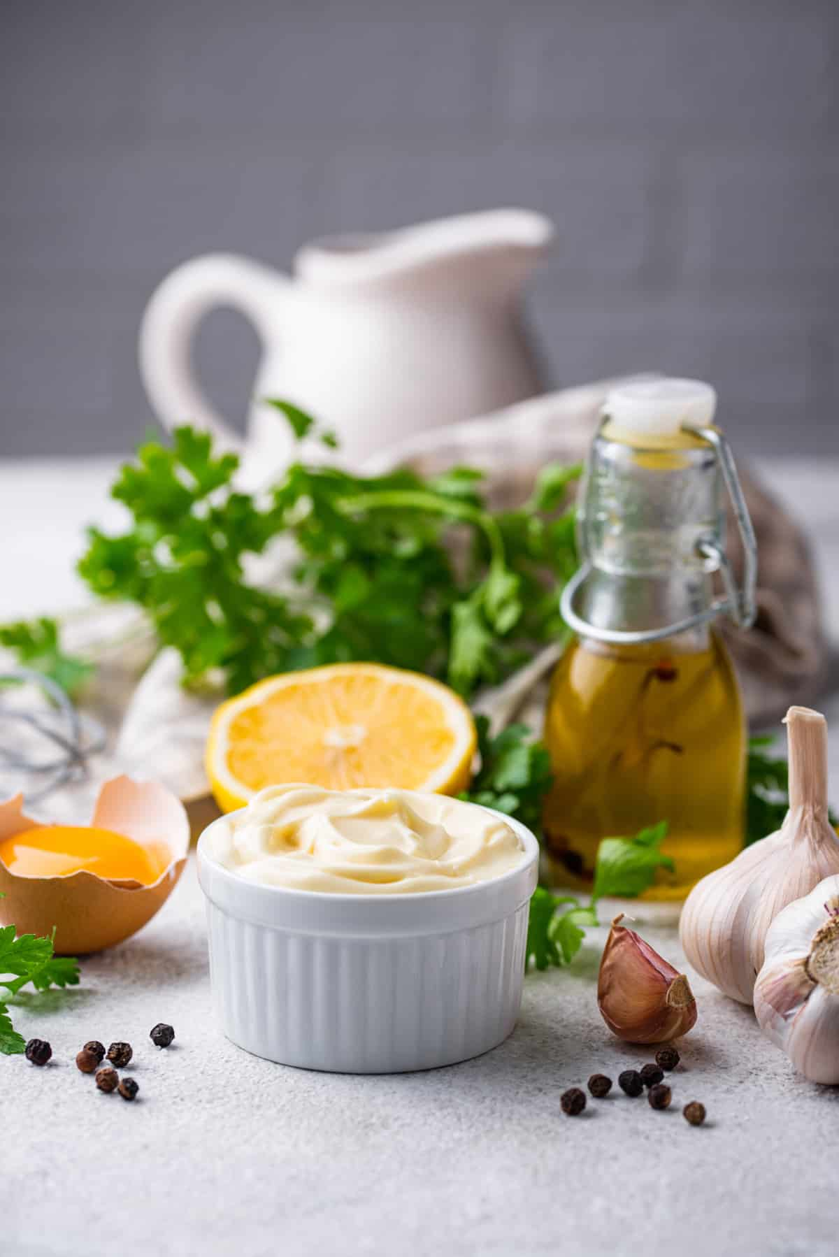 ingredients for a homemade mayonnaise recipe - eggs, garlic, oil, salt, pepper