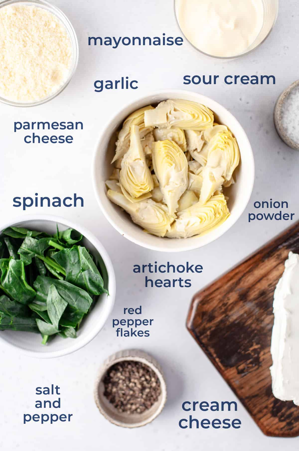 Ingredients for Hot Spinach and Artichoke Dip - cream cheese, parmesan, sour cream, mayo, garlic, spinach, artichoke, seasonings