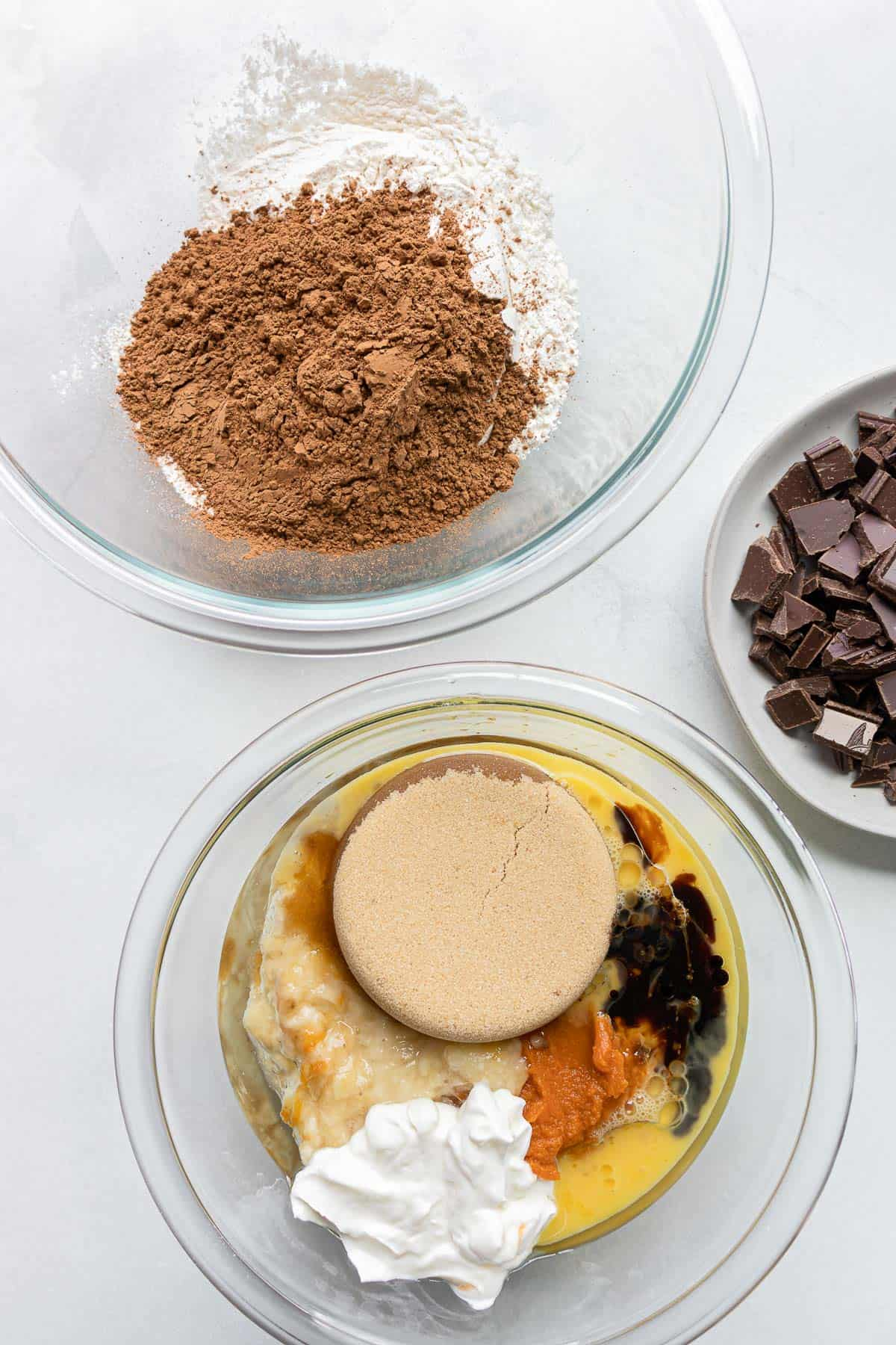 Ingredients for chocolate banana bread - flour, sugar, banana, eggs, chocolate, baking soda, salt