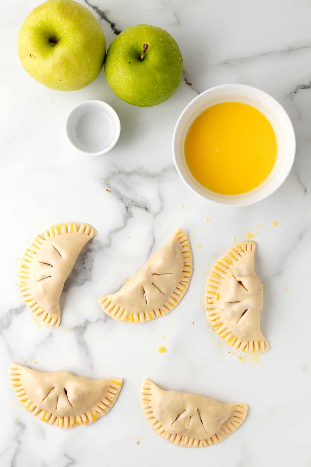 mini apple hand pies ready to be cooked
