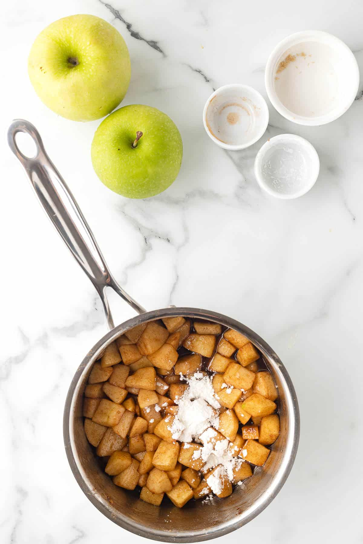 sauce pan with apples, brown sugar, and cinnamon and cornstarch to make apple pie