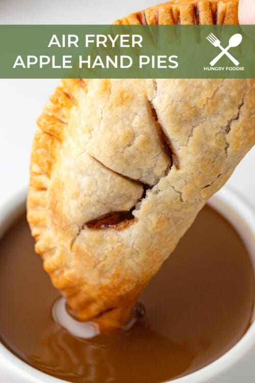 Air Fryer Apple Hand Pies Being Dipped into Caramel Sauce