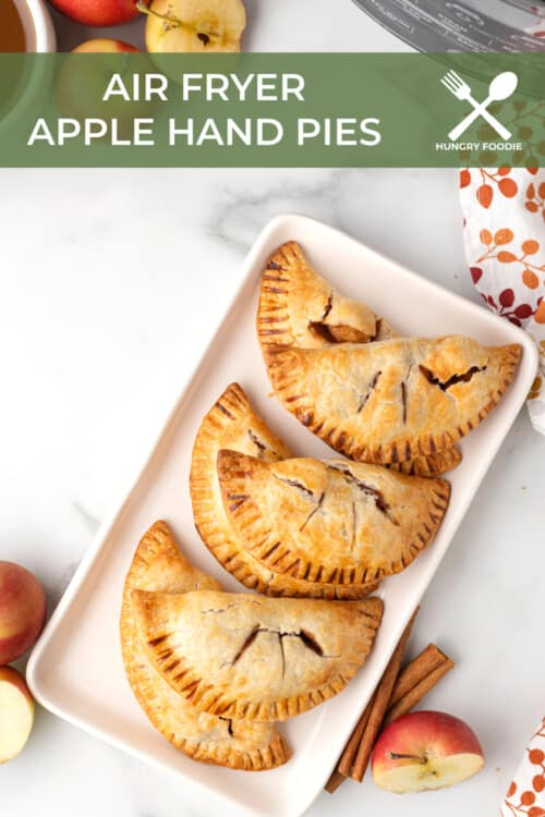 a white platter full of mini apple pies made in the air fryer