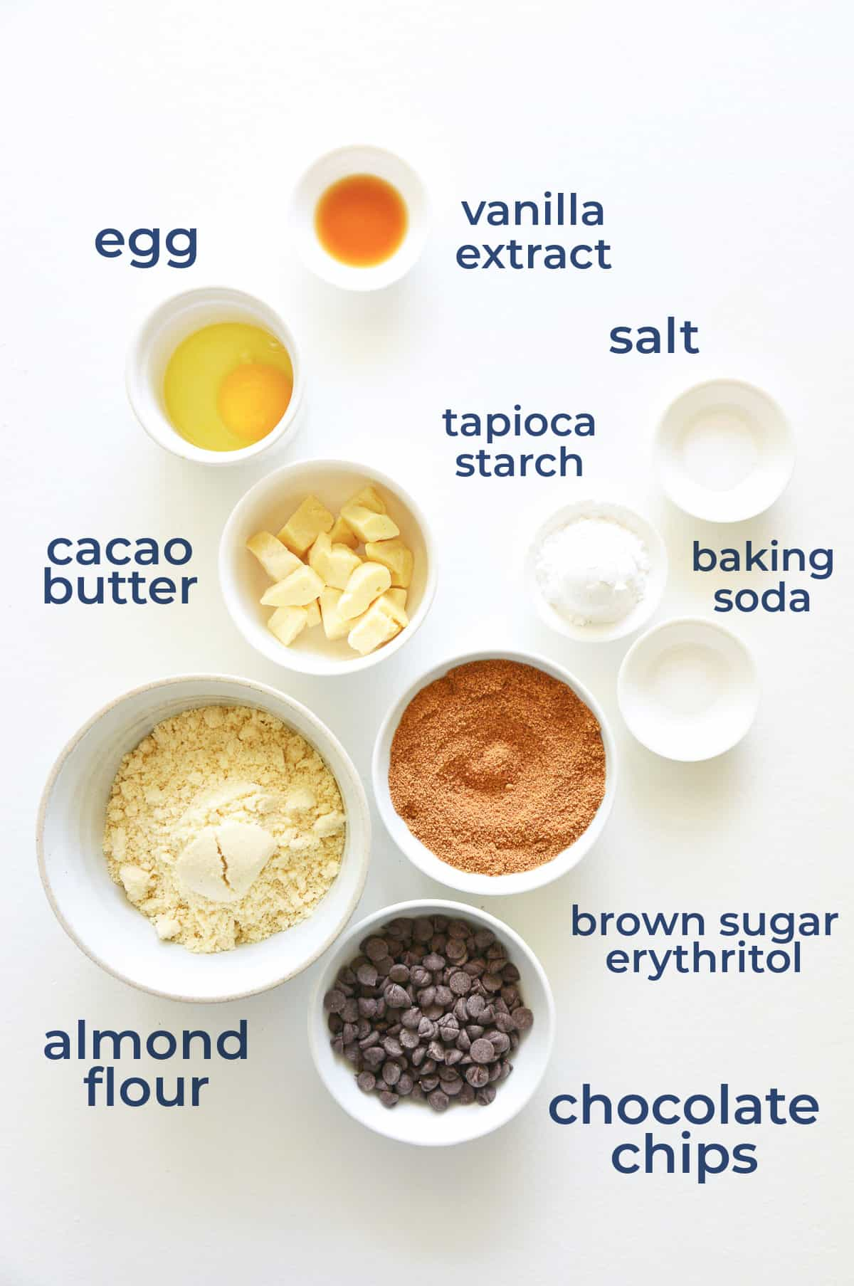 Ingredients all laid out in individual bowls to make low carb and gluten free chocolate chips cookies
