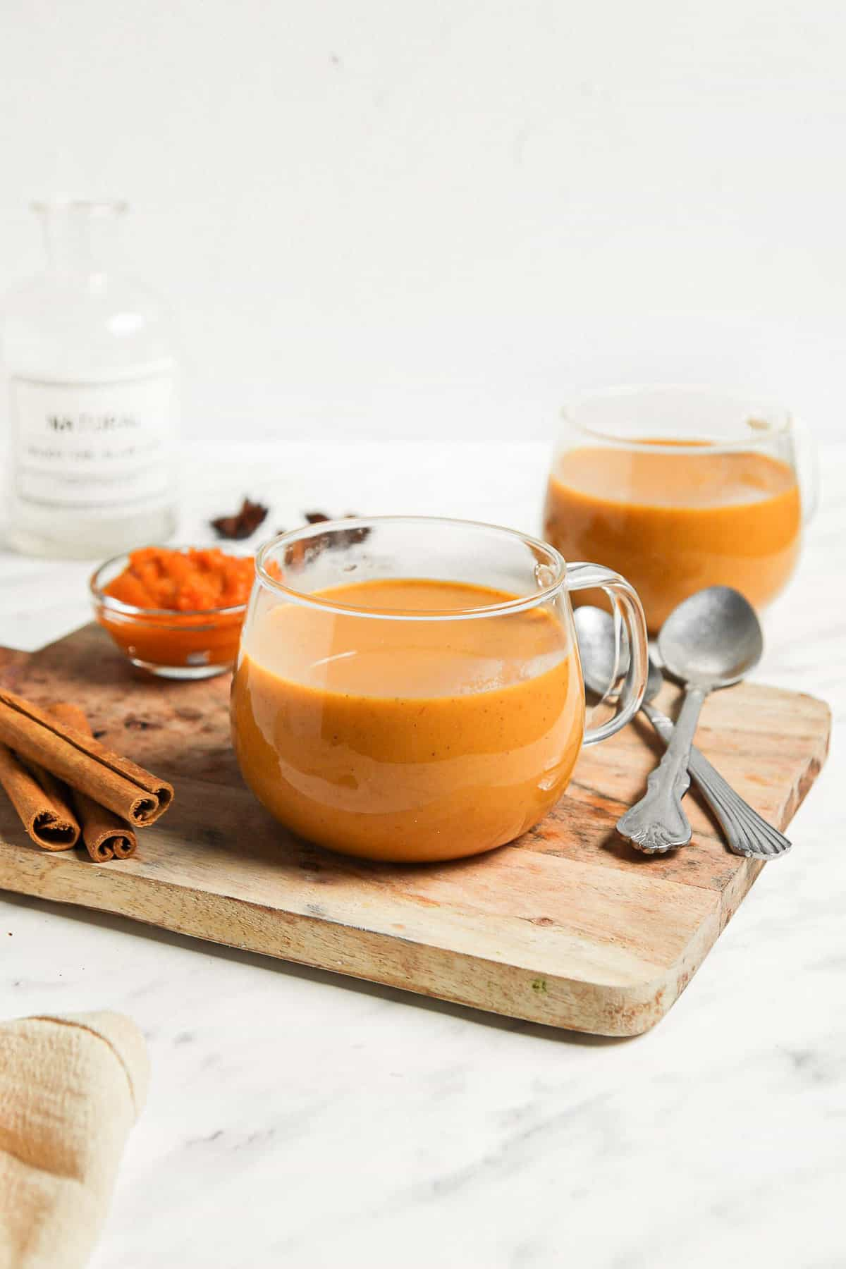 a clear glass coffee mug, filled with a homemade pumpkin spice latte