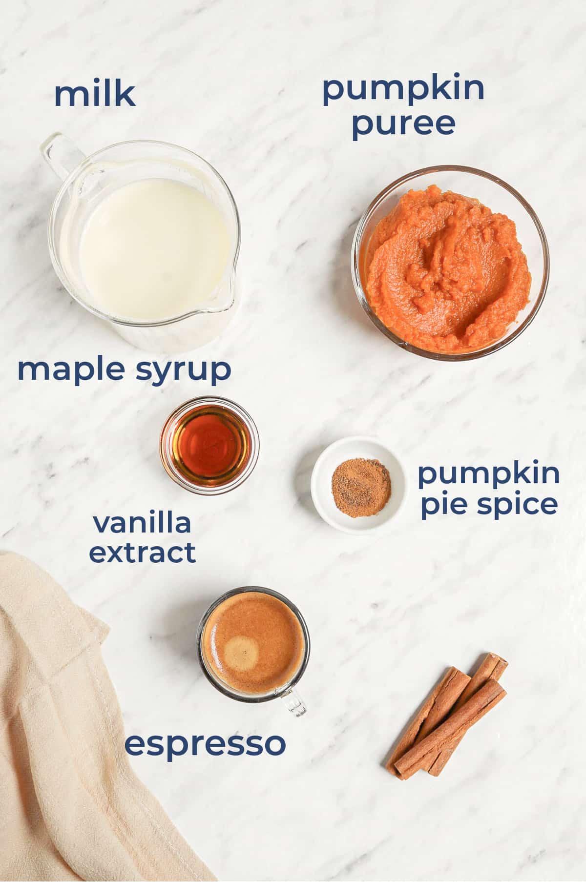 ingredients to make homemade pumpkin spice latte recipe - pumpkin puree, milk, vanilla, syrup, spices
